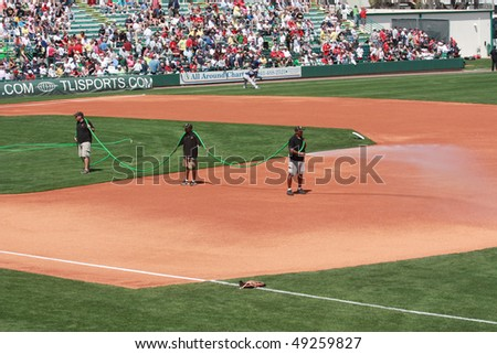 BRADENTON, FLORIDA- MARCH 19:  Field operators water down the field before the start of the game on March 19, 2010 in Bradenton, Florida.
