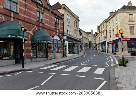 BRADFORD ON AVON - JUL 19: Street view in the old town on Jul 19, 2014 in Bradford on Avon, UK. The historic Wiltshire town was a centre for the wool industry during the industralisation era.  - stock photo