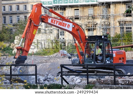 BRADFORD ON AVON - OCT 27: A excavator works on a construction site in the town centre on Oct 27, 2009 in Bradford on Avon, UK. The historic Wiltshire town is undergoing redevelopment. - stock photo