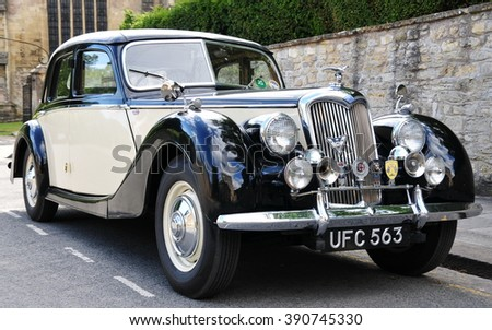 BRADFORD ON AVON, UK - JULY 18, 2010: A Riley Motors RM series is seen parked on a street. Manufactured from 1945 to 1957 the RM series had a top speed of 80mph with 0-60 in 25s. - stock photo