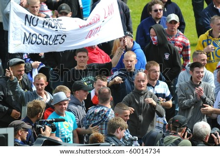 BRADFORD, WEST YORKSHIRE – AUG 28 : Police clash with EDL (English Defence League) supporters and Islamic protesters during a supposed peaceful demonstrations August 28, 2010 in Bradford, England