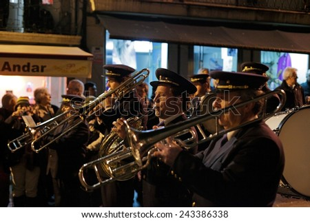 Braga, Portugal - April 1, 2010: Brass band playing during the religious procession of the Ecce Homo, Holy Week (High ISO photo) - stock photo