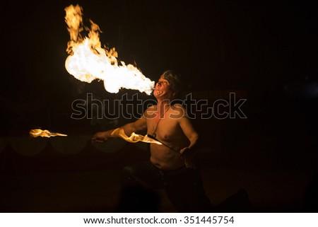 BRAGA, PORTUGAL - DECEMBER 13: Fire eater performing at Cardinali Circus on December 13, 2015 in Braga, Portugal. - stock photo