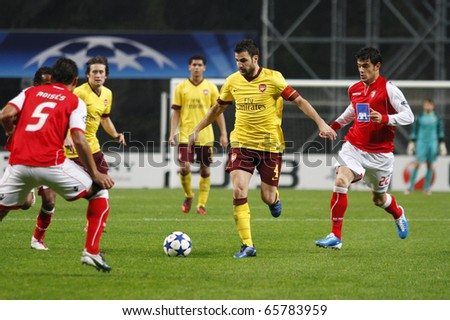 BRAGA, PORTUGAL - NOVEMBER 23: Cesc Fabregas(M),Arsenal (ENG),leads his team into atack,near Luis Aguiar(R) Braga (POR) at the UEFA Champions League match on November 23th, 2010 in Braga, Portugal - stock photo