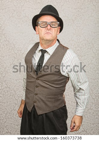 Bragging single businessman with hat and eyeglasses - stock photo