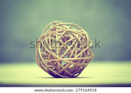 Braided ball of wood, eco decoration. Contemporary art. Filter instagram - stock photo