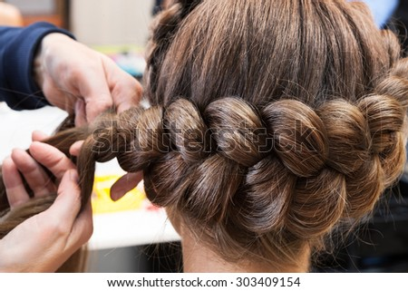 braided braids brunette at the beauty salon - stock photo