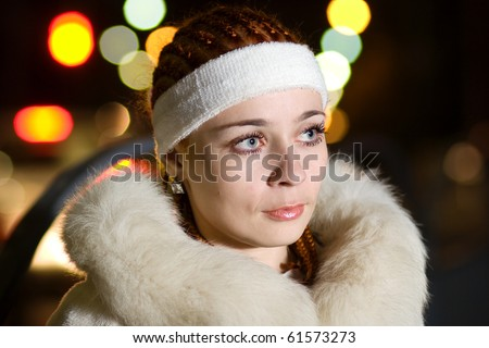 Braided young lady in white fur coat - stock photo