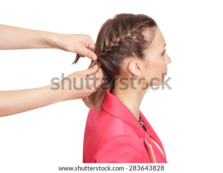 Braiding. A French braid with two side grabs