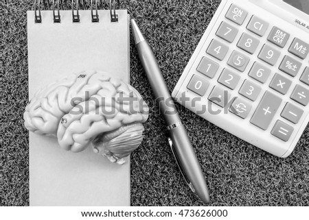brain and calculator  with black and white color in business concept