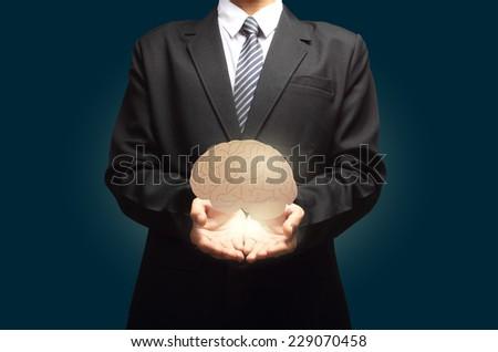 Brain in hand - stock photo