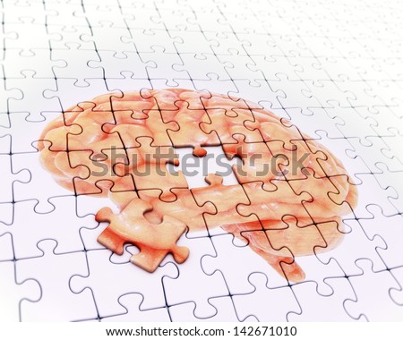 Brain jigsaw puzzle - memory concept illustration - stock photo