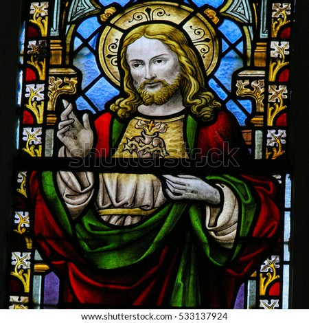 BRAINE-LE-CHATEAU, BELGIUM - JULY 31, 2009: Stained Glass window in the Church of Braine-le-Chateau, Wallonia, Belgium, depicting Jesus Christ and the Sacred Heart