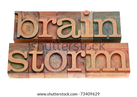brainstorm word in vintage wood letterpress printing blocks, stained by color inks, isolated on white