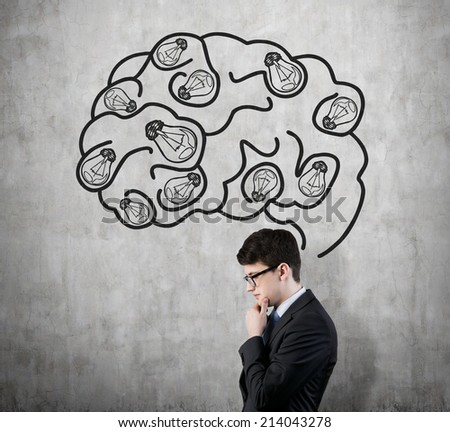 Brainstorming and inspiration concept. Businessman and sketched brain. - stock photo