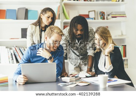 Brainstorming event between colleagues at work in office - stock photo