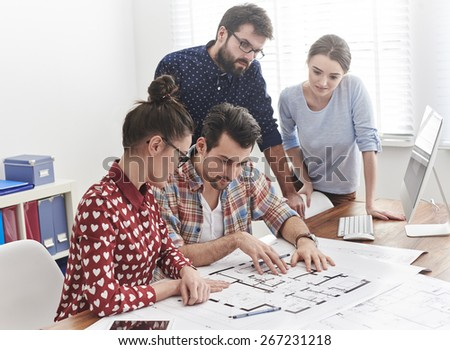 Brainstorming with coworkers at the office - stock photo