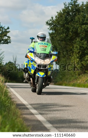 BRAINTREE UK - SEPTEMBER 10: Tour of Britain Cycle Race - Police motorcycle outrider during Essex Stage, Braintree, Essex, September 10, 2008 - stock photo