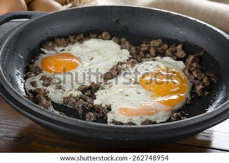 Braised beef with egg on iron cast pan close up - stock photo