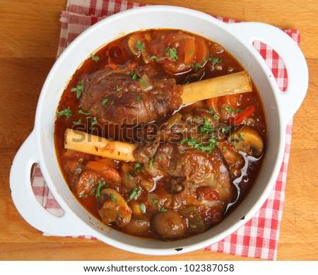 Braised lamb shanks in casserole dish - stock photo