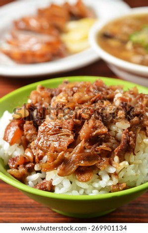 Braised pork rice on wood table - stock photo