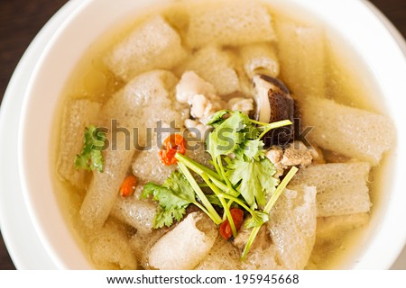 Braised Pork soup with Chinese herb and bamboo in white bowl - stock photo