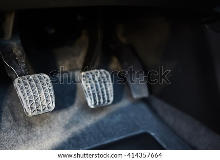 Brake and accelerator pedal of car - stock photo