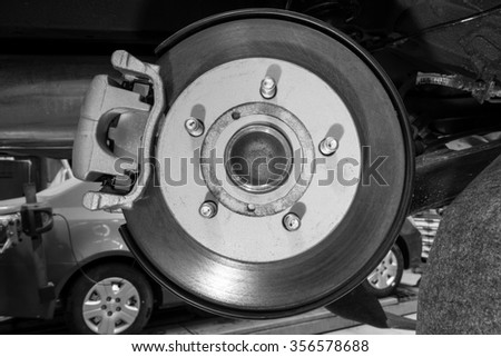 Brake caliper and disc assembly of a new vehicle