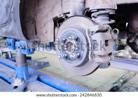 Brake disk and caliper assembly - stock photo