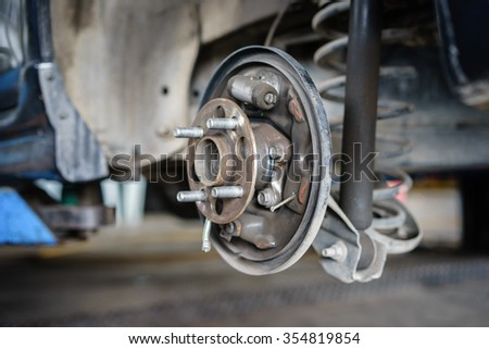 brake disk and detail of the wheel assembly. - stock photo