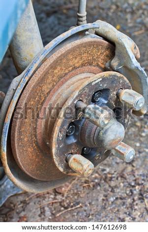 brake old rusted disc brake and caliper on car  - stock photo