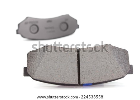 brake shoes on a white background. car parts - stock photo