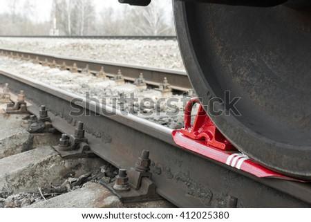 brake wheel on railway of train - stock photo