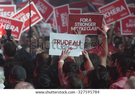 "BRAMPTON - OCTOBER 4 : Followers  waiving a ""Trudeau"" sign  with during an election rally of the Liberal Party of Canada on October 4, 2015 in Brampton, Canada."