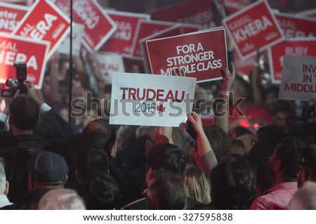 "BRAMPTON - OCTOBER 4 : Followers  waiving a ""Trudeau"" sign  with during an election rally of the Liberal Party of Canada on October 4, 2015 in Brampton, Canada. - stock photo"