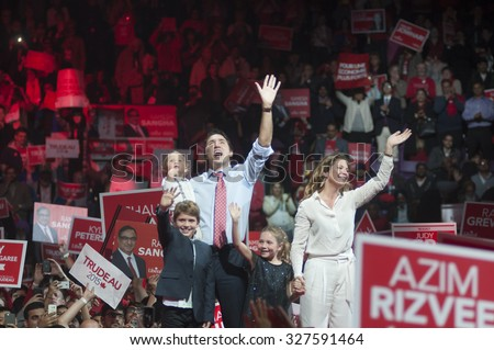 BRAMPTON - OCTOBER 4 :Justin Trudeau and his family waiving towards their party supporters during an election rally of the Liberal Party of Canada on October 4, 2015 in Brampton, Canada. - stock photo