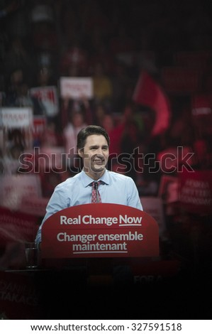 BRAMPTON - OCTOBER 4 :Justin Trudeau sharing a lighter moment during an election rally of the Liberal Party of Canada on October 4, 2015 in Brampton, Canada. - stock photo