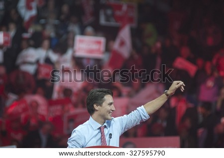 BRAMPTON - OCTOBER 4 :Justin Trudeau  waiving towards the crowd during an election rally of the Liberal Party of Canada on October 4, 2015 in Brampton, Canada. - stock photo
