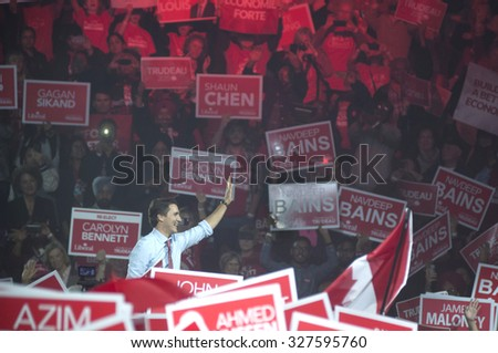 BRAMPTON - OCTOBER 4 :Justin Trudeau waving to his follwers while entering the arena during an election rally of the Liberal Party of Canada on October 4, 2015 in Brampton, Canada. - stock photo