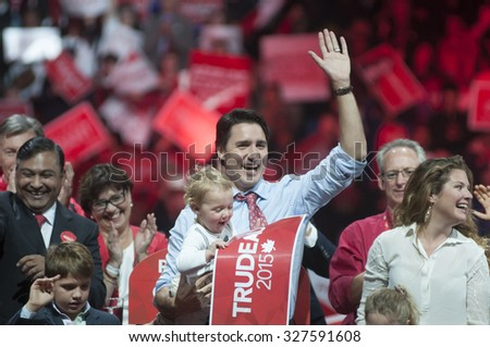 BRAMPTON - OCTOBER 4 :Justin Trudeau with his son and wife waiving towards his supporters during an election rally of the Liberal Party of Canada on October 4, 2015 in Brampton, Canada. - stock photo