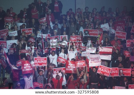 BRAMPTON - OCTOBER 4 : Liberal party supporters chanting slogans and hoisting banners during an election rally of the Liberal Party of Canada on October 4, 2015 in Brampton, Canada. - stock photo