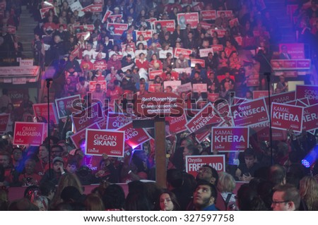 "BRAMPTON - OCTOBER 4 : Liberal party supporters gathered at the ""Powerade Centre"" during an election rally of the Liberal Party of Canada on October 4, 2015 in Brampton, Canada. - stock photo"
