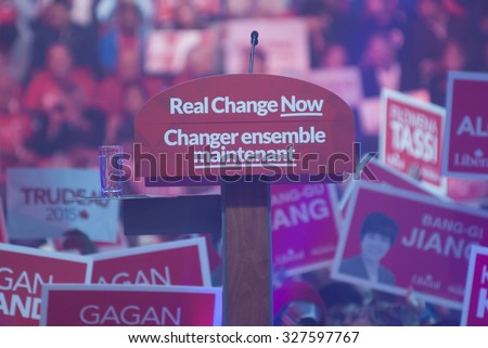 "BRAMPTON -OCTOBER 4:""Real Change Now"" the tagline of the liberal party being displayed under the microphone in an election rally of the Liberal Party of Canada on October 4,2015 in Brampton,Canada."