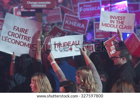 "BRAMPTON - OCTOBER 4 :Supporters holding ""Trudeau 2015"" signs during an election rally of the Liberal Party of Canada on October 4, 2015 in Brampton, Canada. - stock photo"