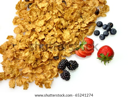bran and raisin cereal  with fruits and berries - stock photo