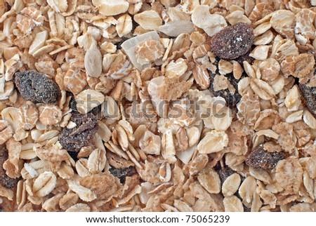 Bran and raisin cereals background, food texture. - stock photo