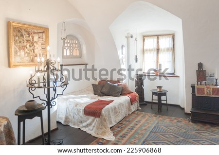 BRAN, ROMANIA - OCTOBER 27, 2013:  One of the bedrooms of the Dracula Castle in Bran, Romania, on October 27, 2013.It is marketed as the home of the Vampire Dracula, the Bram Stoker's novel character.