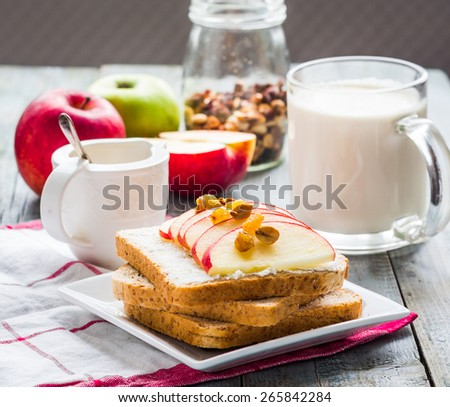 bran toast with cheese, apple and dried fruits, healthy breakfast, clean eating - stock photo