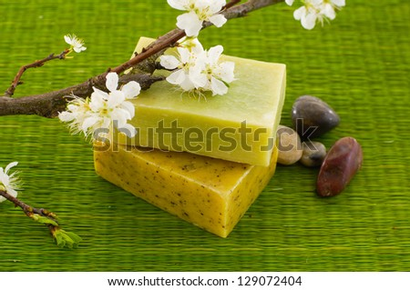 branch cherry flowers and handmade soap ,stones on green mat