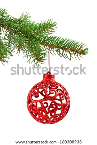 Branch of Christmas tree and red ball on white background - stock photo